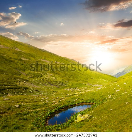 small lake in a green mountains - stock photo