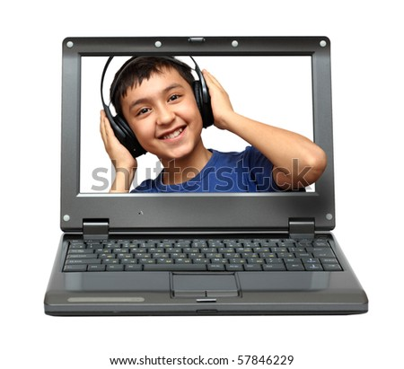small laptop with child listening music in headphones - stock photo