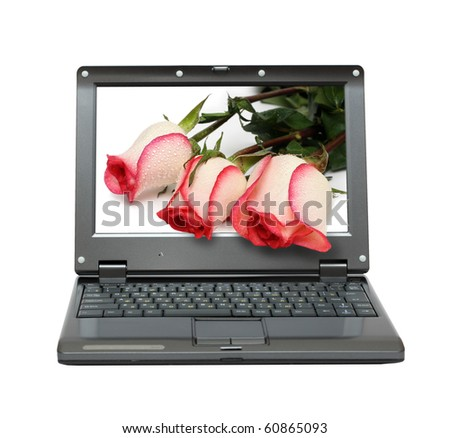 small laptop with roses bouquet out of screen
