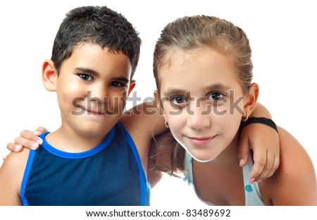 Small latin boy and girl hugging isolated on a white background - stock photo