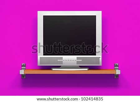 Small LCD tv in a purple room - stock photo