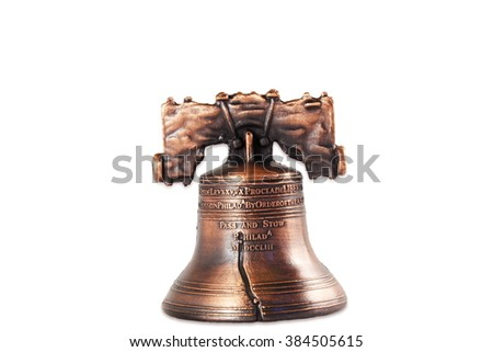 small liberty bell idol reproduction isolated on white background - stock photo