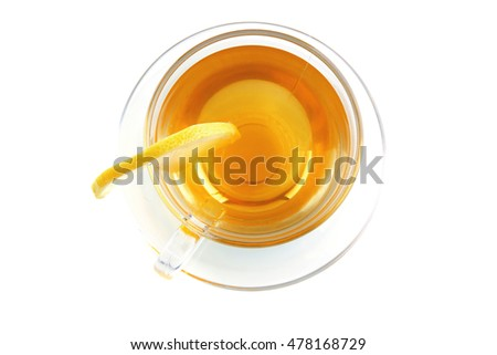 small light tea transparent glass cup with lemon cut isolated on white background