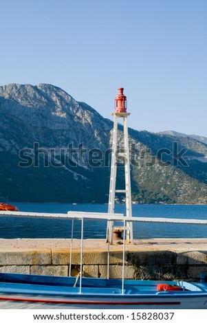 Small lighthouse and boat at dock