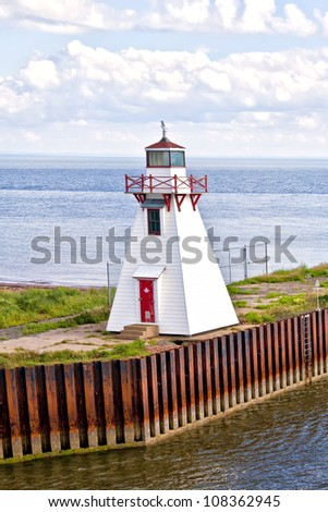 Small lighthouse on a wharf in Wood Islands, Prince Edward Island, Canada. - stock photo