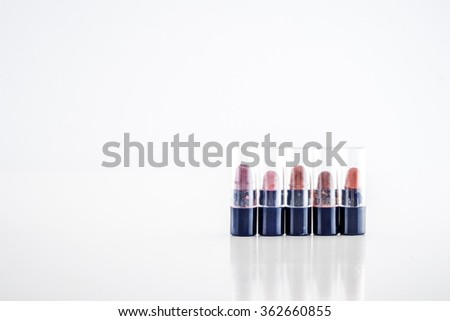 Small lipstick testers from different range of colors on white background