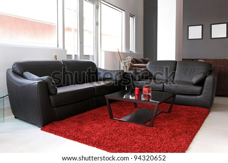 Small living room interior with leather furniture - stock photo