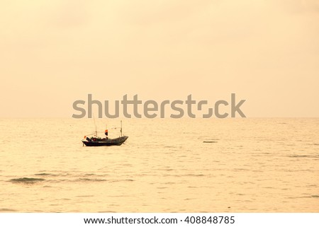 Small lonely fishing boat floating on flat surface of adriatic sea on calm morning. - stock photo
