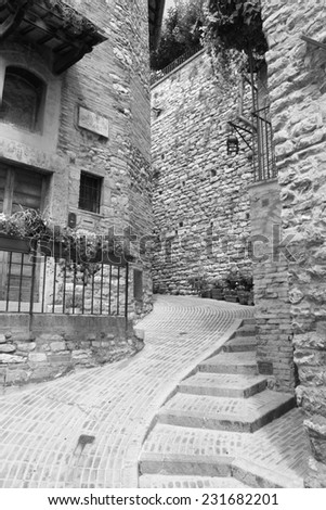 Small medieval alley in Assisi city ( Umbria Italy ) - stock photo