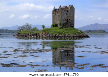 small medieval castle stalker on small island in loch linnhe argyll in the scottish highlands - stock photo