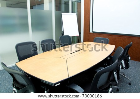 Small meeting room with flip chart - stock photo