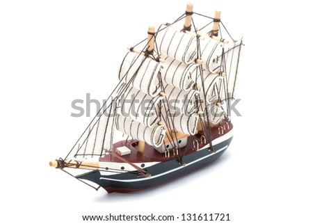 Small model ship isolated on white background. - stock photo