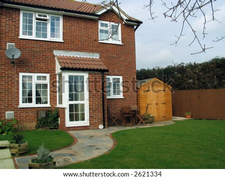 small modern english brick house and garden - stock photo