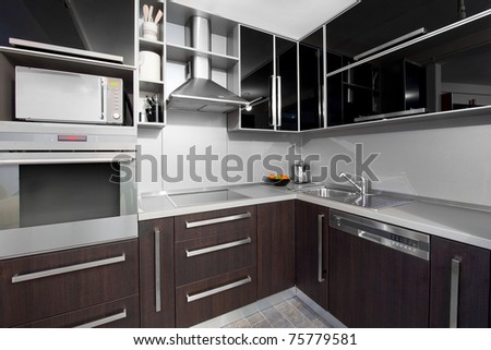 Small modern kitchen in black and wenge colors - stock photo
