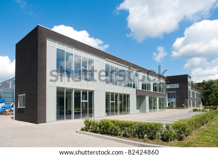 small modern office building against a nice cloudy sky - stock photo