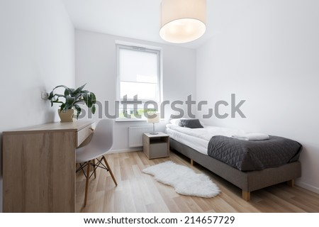Small, modern sleeping room interior design in scandinavian style - stock photo
