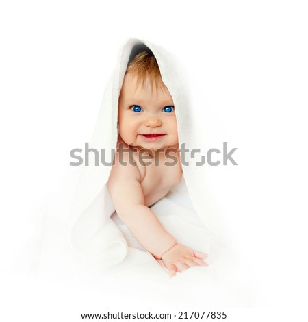 Small 4 months baby after bathing  wrapped in a towel. Isolated on white background. Ready for your text, symbol or advertising. - stock photo
