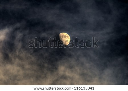 Small Moon with clouds - stock photo