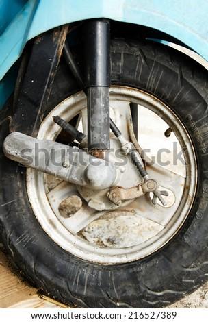 Small motorbike front wheel. - stock photo