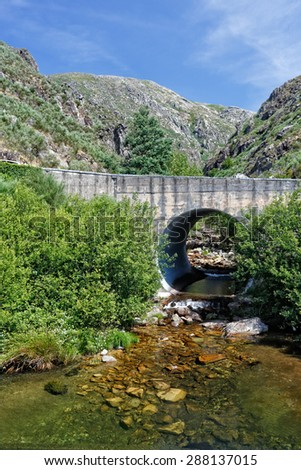 Small mountain bridge over a creek from the Peneda Geres National Park, north of Portugal - stock photo