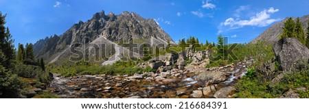 Small mountain river in Siberia. Barun-Handagay. Sayan mountains. Republic of Buryatia - stock photo