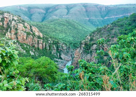 Small mountain river that enters Paris Dam. Shot in South Africa.  - stock photo