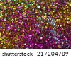 Small multicolored sequins as background, unfocused                  - stock photo