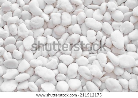 Small naturally white rock pebbles. - stock photo