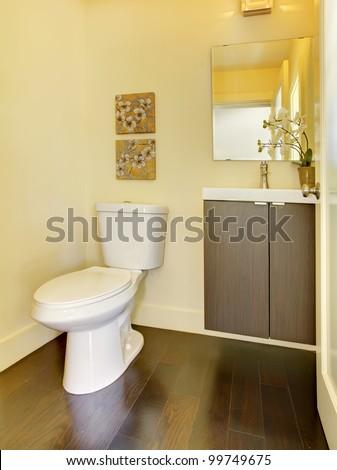 Small new modern yellow bathroom. - stock photo