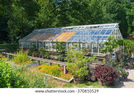 small non commercial greenhouse exterior - stock photo
