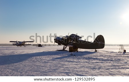 Small north airfield with planes - stock photo