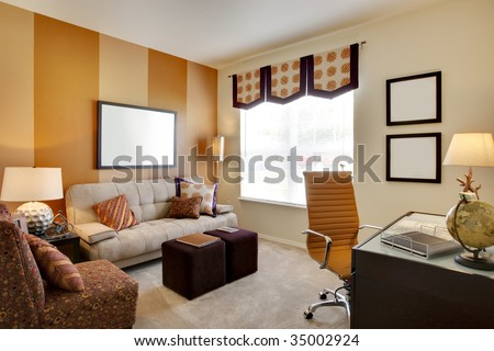 Small office space room with orange accent walls and desk - stock photo