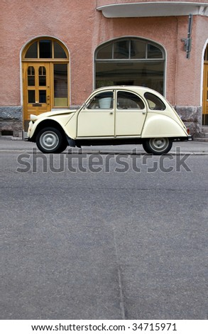 Small Old Car in the City - stock photo