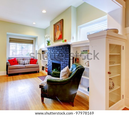 Small old house classic living room interior with black fireplace. - stock photo
