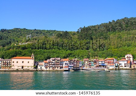 Small old houses in the beginning of the harbour of Pasaia in the Donibane district east of San Sebastian - stock photo