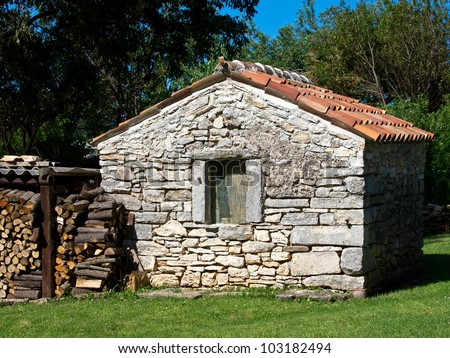 Small old stone house fire wood stock photo royalty free for Small stone house