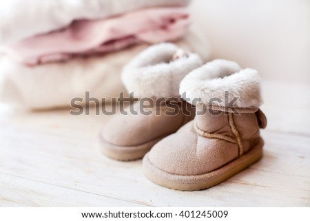 small pair  baby  ugg on white background - stock photo
