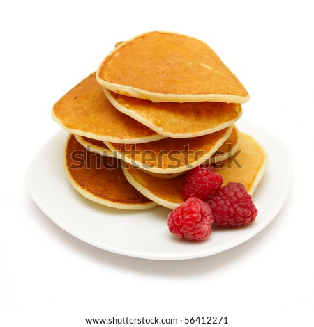 small pancakes topped with berries isolated on white - stock photo