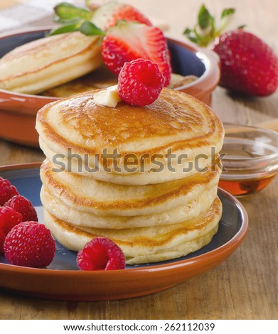 Small pancakes with fresh berries  . Selective focus