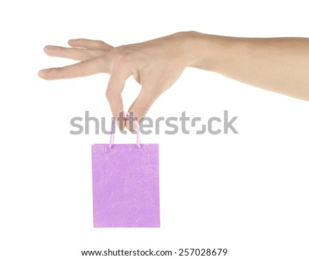 Small paper bag in big hand isolated on white - stock photo