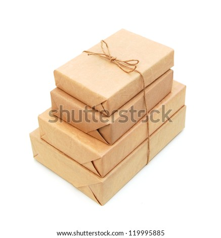 Small parcel wrapped in brown paper - stock photo