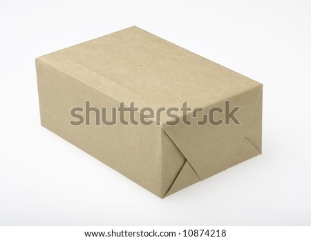 Small parcel wrapped in plain brown paper. White background. - stock photo