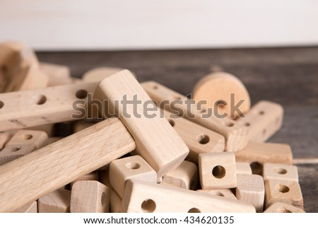Small particles of toy wooden constructions