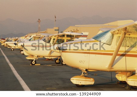 Small passenger aircrafts parked at the airport - stock photo