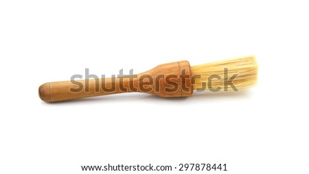 Small pastry brush with a wooden handle, isolated on a white background - stock photo