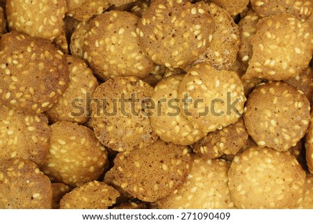 small pastry with sesame abstract background - stock photo