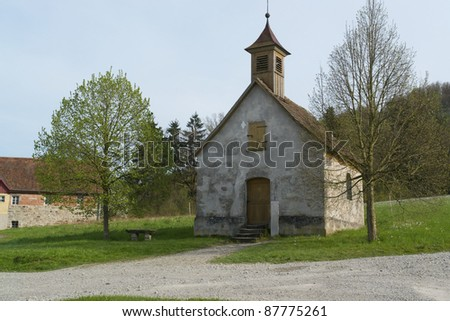 small peaceful chapel in Wackershofen in Southern Germany at spring time - stock photo