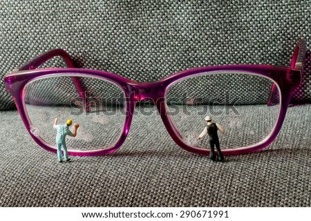 Small people, clean glasses. The concept of teamwork. - stock photo