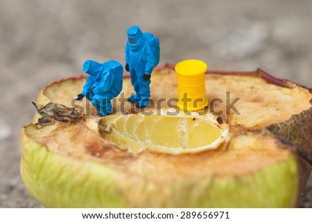 Small people control the food. The concept, wasting food. - stock photo