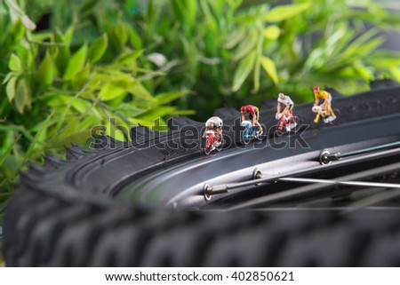 Small people racing on bicycles. The concept of sport. - stock photo